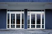 Glass doors of entrance in modern building.                poster