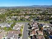 Aerial View Of Residential Suburban Packed Homes Neighborhood During Blue Sky Day In Irvine, Orange  poster