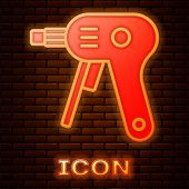 Glowing Neon Electric Hot Glue Gun Icon Isolated On Brick Wall Background. Hot Pistol Glue. Hot Repa poster