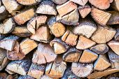 Preparation Of Firewood For Winter. Storage Of Firewood poster