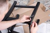 Man Assembling Of Wooden Furniture With Use Of Tools, Close-up. Small Carpentry Work In Workshop. poster