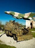 image of military personnel  - Military vehicle Armoured personnel carrier and Croatian air forces MIG 21 airplane in Turanj war museum Croatia - JPG