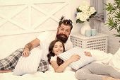 Father Bearded Man With Funny Hairstyle Ponytails And Daughter In Pajamas. Dad And Girl Relaxing In  poster