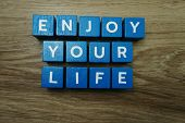 Enjoy Your Life Alphabet Letter With Space Copy On Wooden Background poster