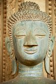 Head Of An Ancient Buddha Statue Located Outside Of The Hor Phra Keo Temple (former Temple Of The Em poster