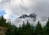 Thick Clouds Hover Around Mountains In Washington Wilderness poster
