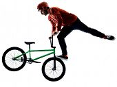 one young caucasian man BMX rider cyclist cycling freestyle acrobatic stunt in studio isolated on wh poster