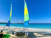 Colorful Sailboats And Motorboat, On A Tropical Beach At Half Moon Cay In The Bahamas On A Tropical  poster