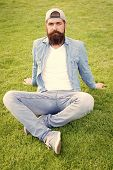 Hairy Hipster. Brutal Hipster Sitting On Green Grass. Bearded Man In Trendy Hipster Style On Summer  poster