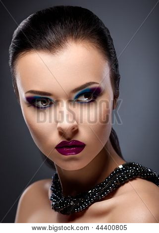 Strict Face Of  Bright Honorable Brunette With Glossy Necklace