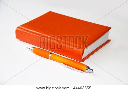 Red Notebook And Pen