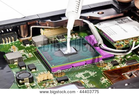 Thermal Compound In Syringe And Laptop Video Chip