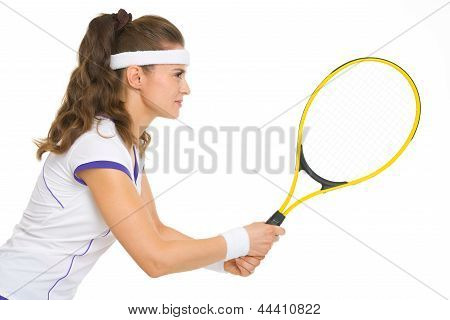 Confident Female Tennis Player In Stance . Side View