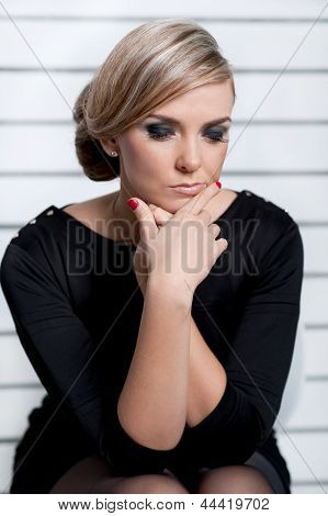 Young Woman Pondering Work