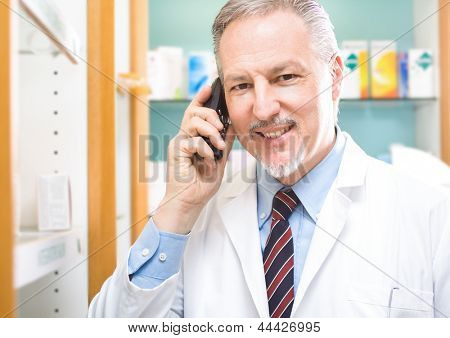 Portrait of an handsome pharmacist at work