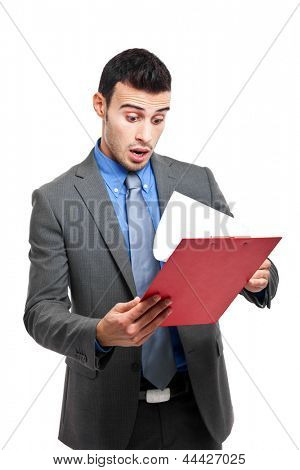 Shocked businessman reading a document. Isolated on white