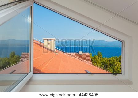 Seaview through open window over mediterranean