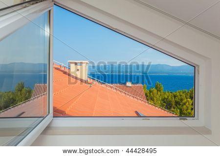 Seaview through open window over mediterranean