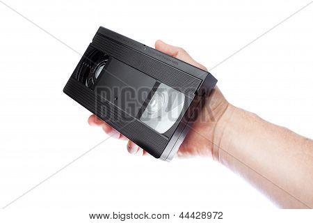 In der Hand eines Mannes alte Videoband-Format Vhs.