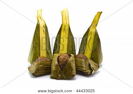 Thai Dessert, Sticky Rice With Manioc, Wrapped In Banana Leaves.