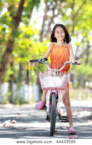 Girl Riding Bicycle Outdoor