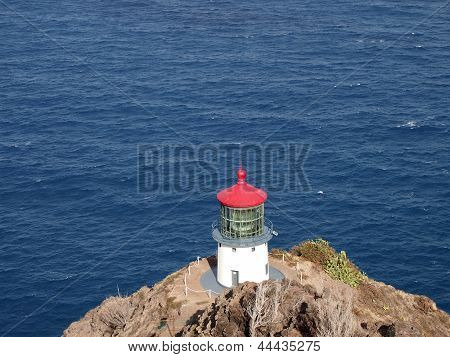 Makapu'u Lighthouse On Cliffside Mountain Top With Ocean Below