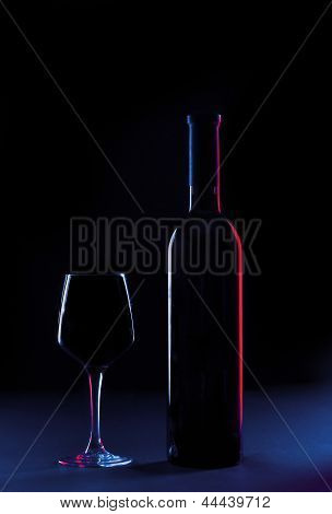 Wine Glass And Bottle On A Background