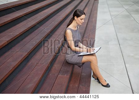 Beautiful Woman Taking Notes
