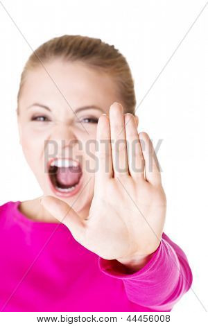 Hold on, Stop gesture showed by young woman hand