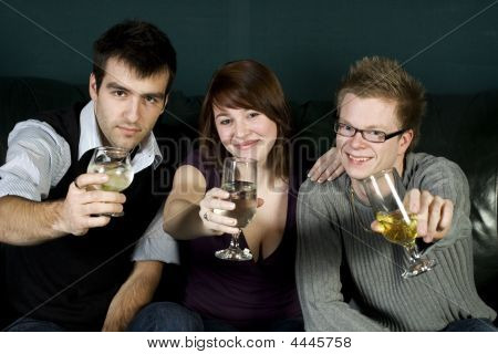Three Friends Toasting To The Camera