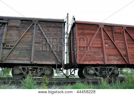 Railroad cars on rails.