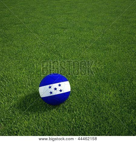 3d rendering of a Honduran soccerball lying on grass