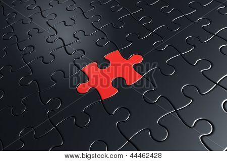 3d rendering of black puzzle pieces with one red piece