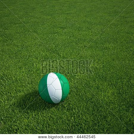 3d rendering of a Nigerian soccerball lying on grass