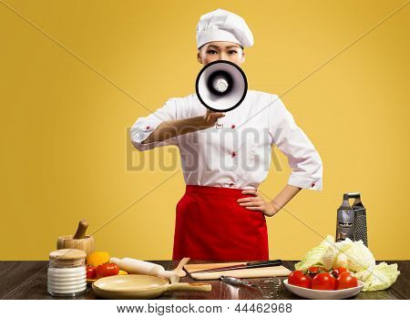 Asian female chef holds a megaphone
