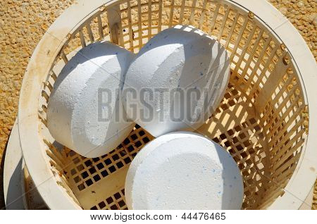 Chlorine tablets in pool skimmer basket.