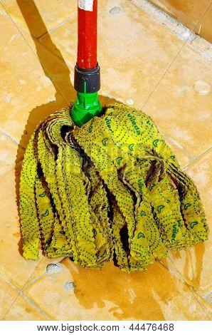 Twister mop head on terracotta tiles.