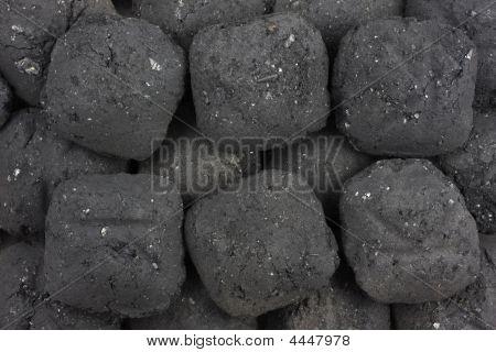 Fondo de briquetas de carbón de leña