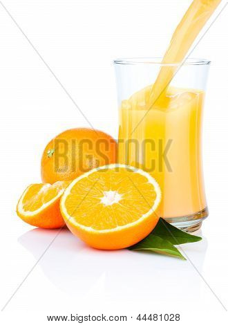 Fresh Oranges Juice Pouring Into A Glass Isolated On White Background
