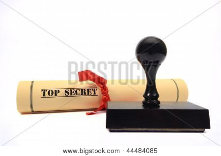 Top secret document and rubber stamp on the white background