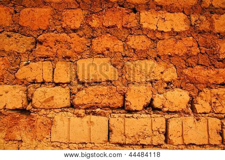 Wall Of Red Earth Bricks
