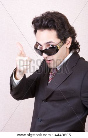 The Businessman In Sunglasses