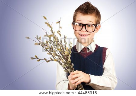 cute boy in a hurry for a date with a bunch of willow
