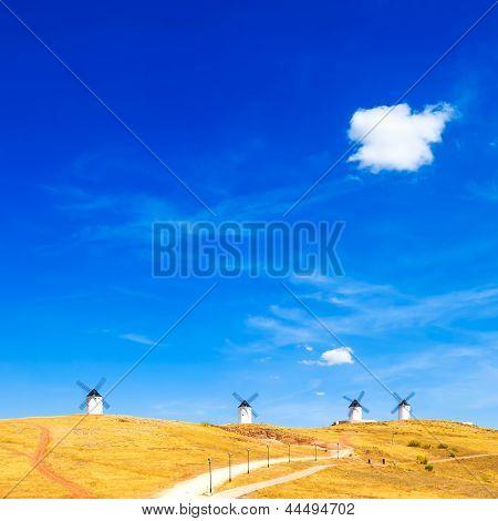 Windmills, Rural Green Fields, Blue Sky And Small Cloud. Consuegra, Spain