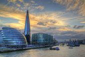 stock photo of city hall  - London City skyline along River Thames during vibrant sunset - JPG