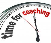 stock photo of pass-time  - The words Time for Coaching on a clock to illustrate the need to learn or be trained by a role model - JPG