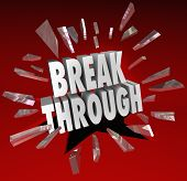 The word Breakthrough breaking through glass to symbolize discovery, invention, creativity, ideas an