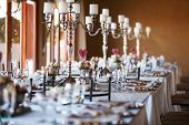 image of crockery  - Beautifully decorated tables with candelabra at wedding reception selective focus - JPG