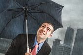 image of poverty  - Businessman under heavy rain - JPG