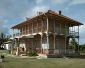stock photo of hacienda  - historic wooden hacienda building seen in Guadeloupe - JPG